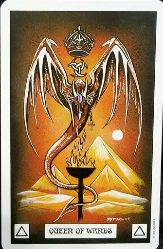 Queen of Wands- A large orange dragon, a crown hovering over its head - looks down upon a flaming torch.