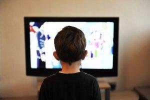 Kid watching TV.