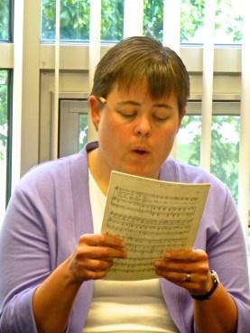 Sr. Nicole sings at choir practice