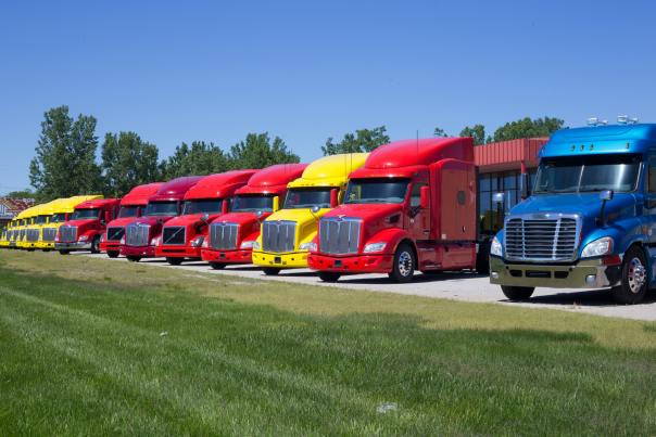 Trucks in three different colors: Yellow, red and blue software depending on the team?