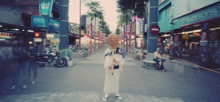 Komuso, priest of nothingness. In bustling Ximen district.