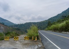 Namasia, highway 21. Completed sections of road are smooth and freshly tarmaced.
