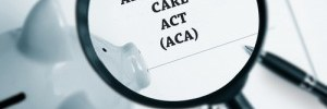 Magnifying glass looking at affordable care act