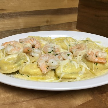 SHRIMP RAVIOLI - House crafted three cheese ravioli topped with shrimp