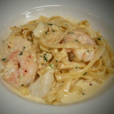 SEAFOOD FETTUCINE - Lobster, scallops, and small prawns sauteed with fettuccine pasta, Served with your choice of a rich creamy Alfredo sauce or a spicy Marinara sauce.