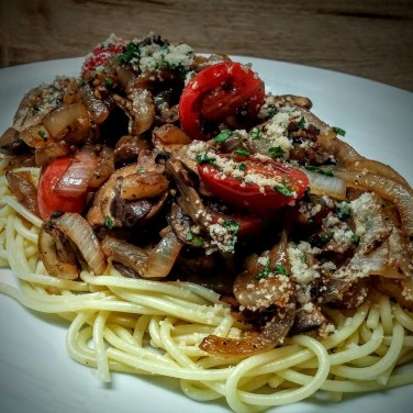 JOES SPECIAL- Sauteed onions, mushrooms, and tomatoes in garlic and extra virgin olive oil sauce. Served over pasta with Asiago cheese