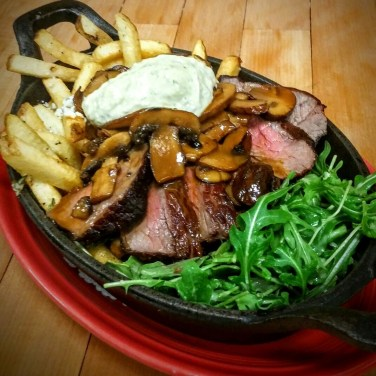 TOP SIRLOIN - served over crispy house made rosemary garlic fries with a mushroon peppercorn sauce, gorgonzola cheese with arugula and a basil aioli
