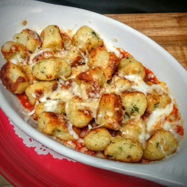GNOCCHI -an Italian house-made potato pasta tossed with your choice of sauce and topped with mozzarella cheese.