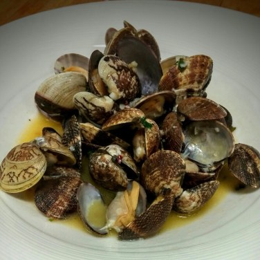 CLAMS - Fresh northwest clams sauteed in a garlic butter white wine sauce.
