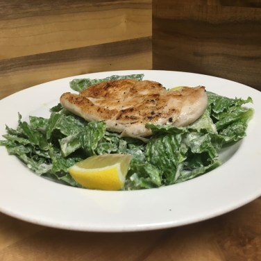 CAESAR SALAD - with our creamy Caesar dressing and fresh Asiago cheese, topped with chicken