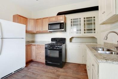 plenty of cabinet space, granite countertops, & gas stove.
