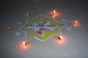 Rangoli with pista shell lamps at my Bangalore flat