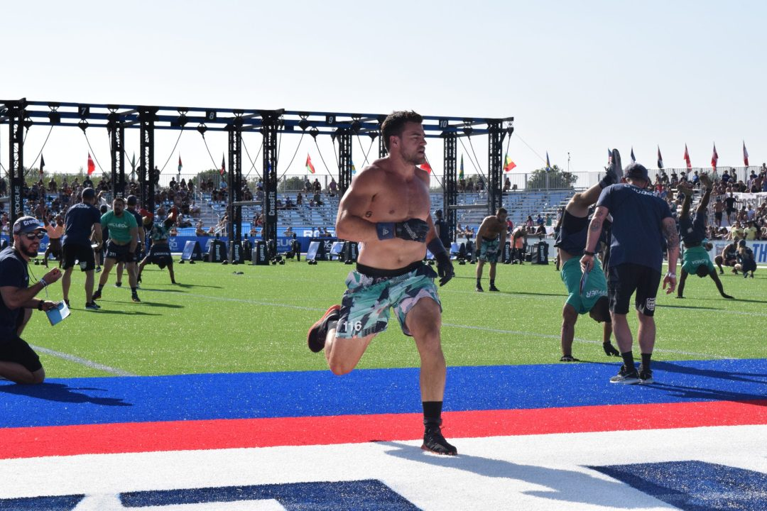 Alex Vigneault crosses the finish line in the second event of the 2019 CrossFit Games