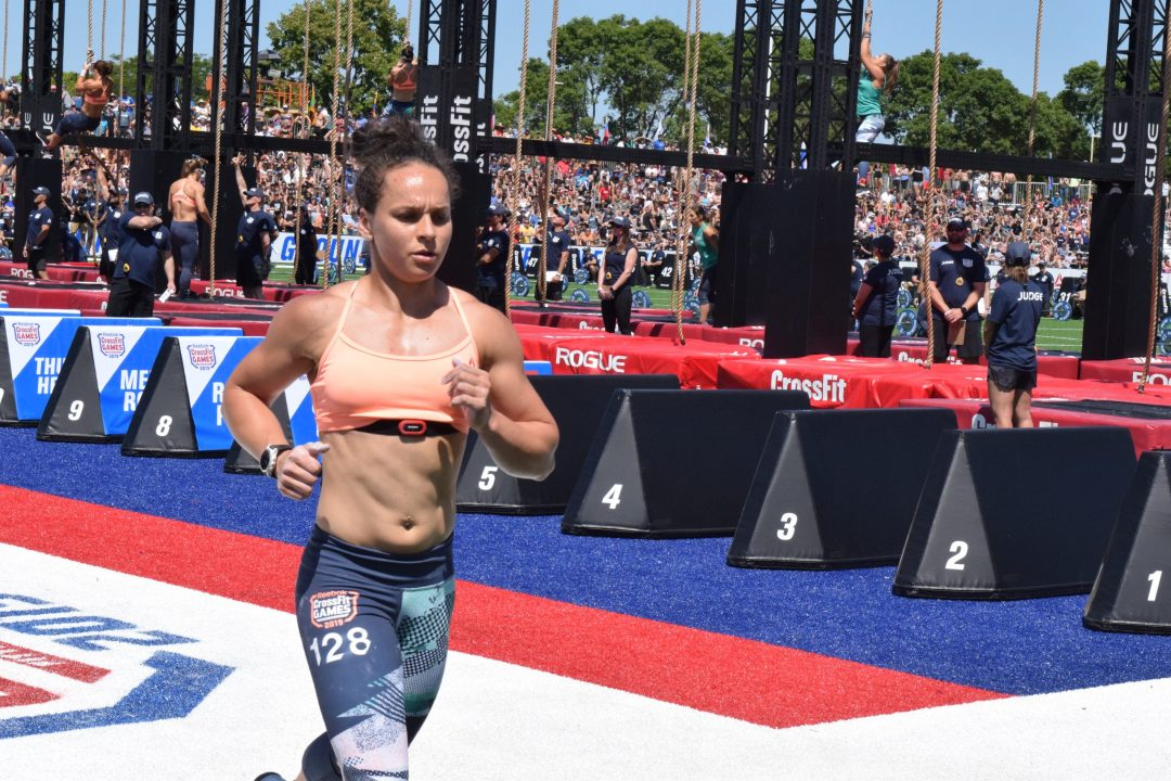 Emma McQuaid takes a lap between rounds of legless rope climbs at the 2019 CrossFit Games