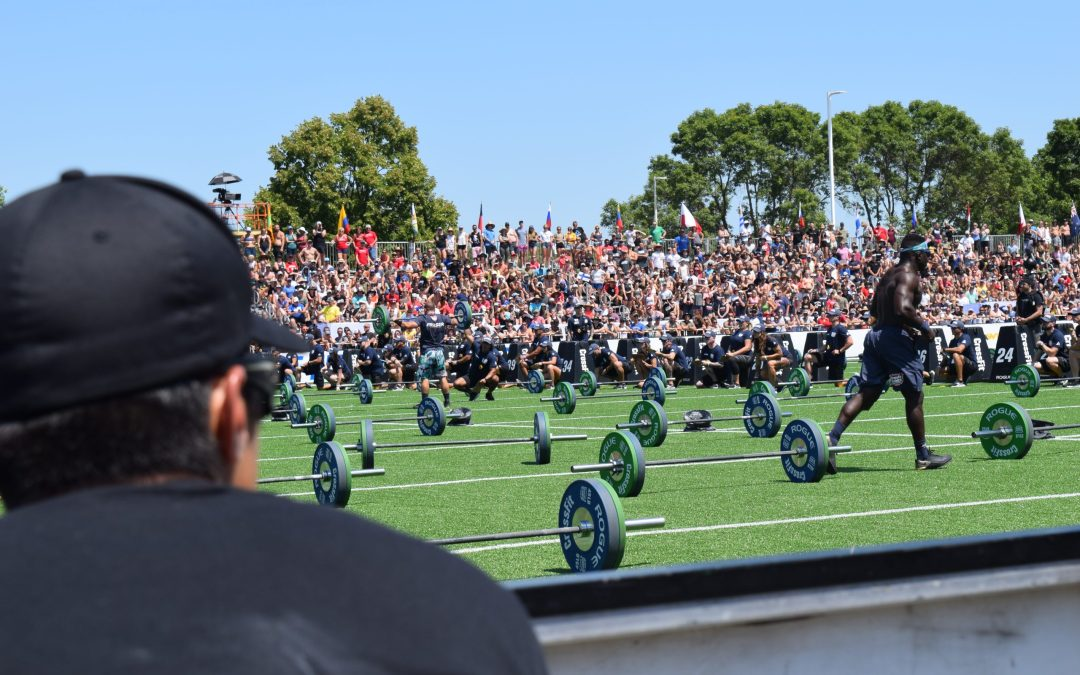 Dave Castro watches Chandler Smith on the field of the 2019 CrossFit Games