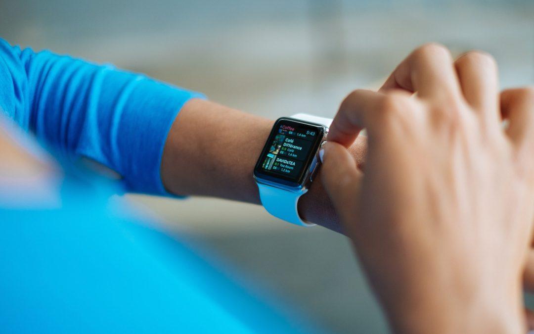 A woman checks an update on her Apple Watch.