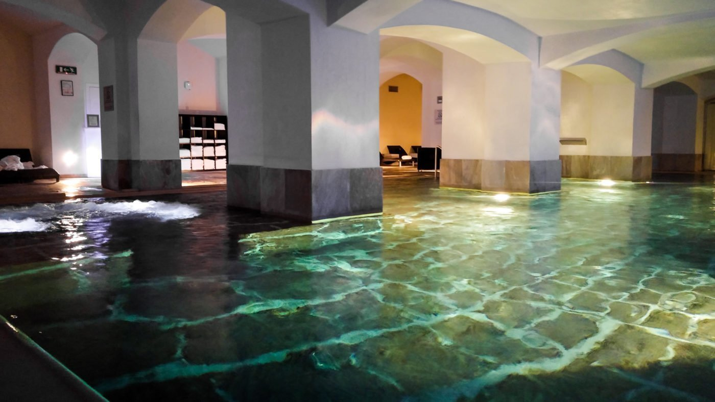 Swim between the pillars of the building in Boscolo's basement swimming pool