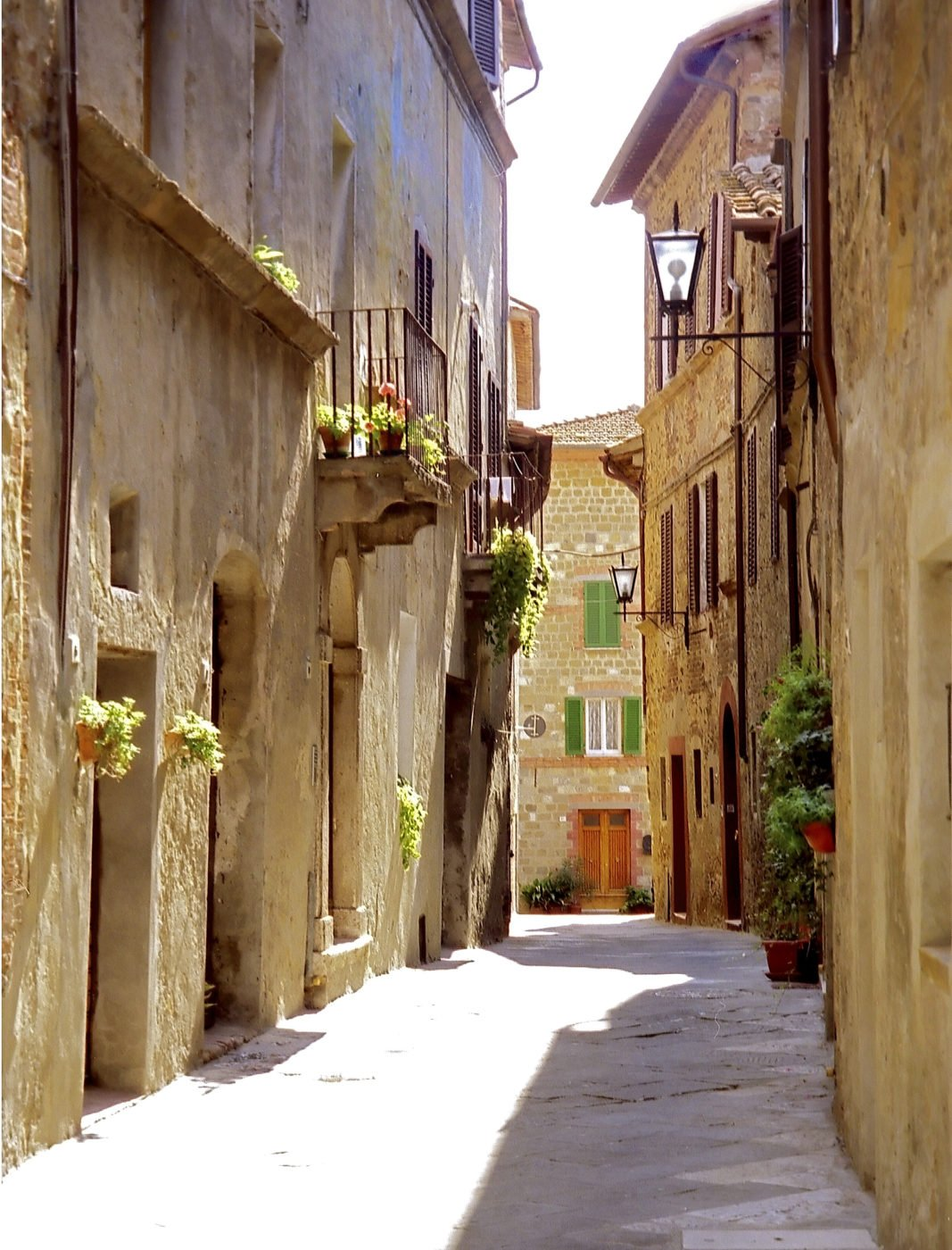 a narrow street in a village in Italy