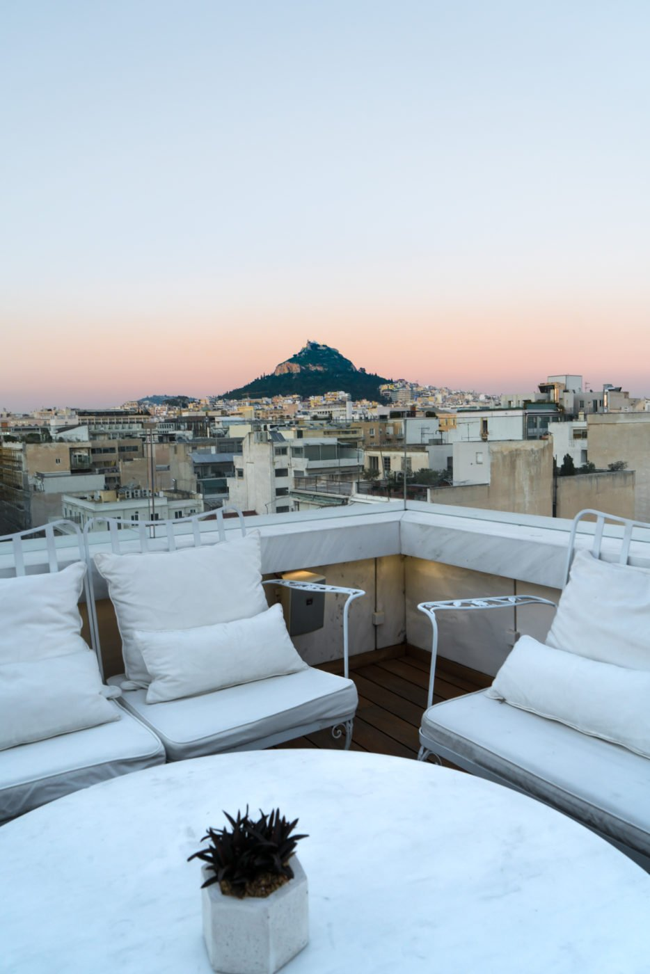 View of Mount Lycabettus from the rooftop bar at NEW Hotel