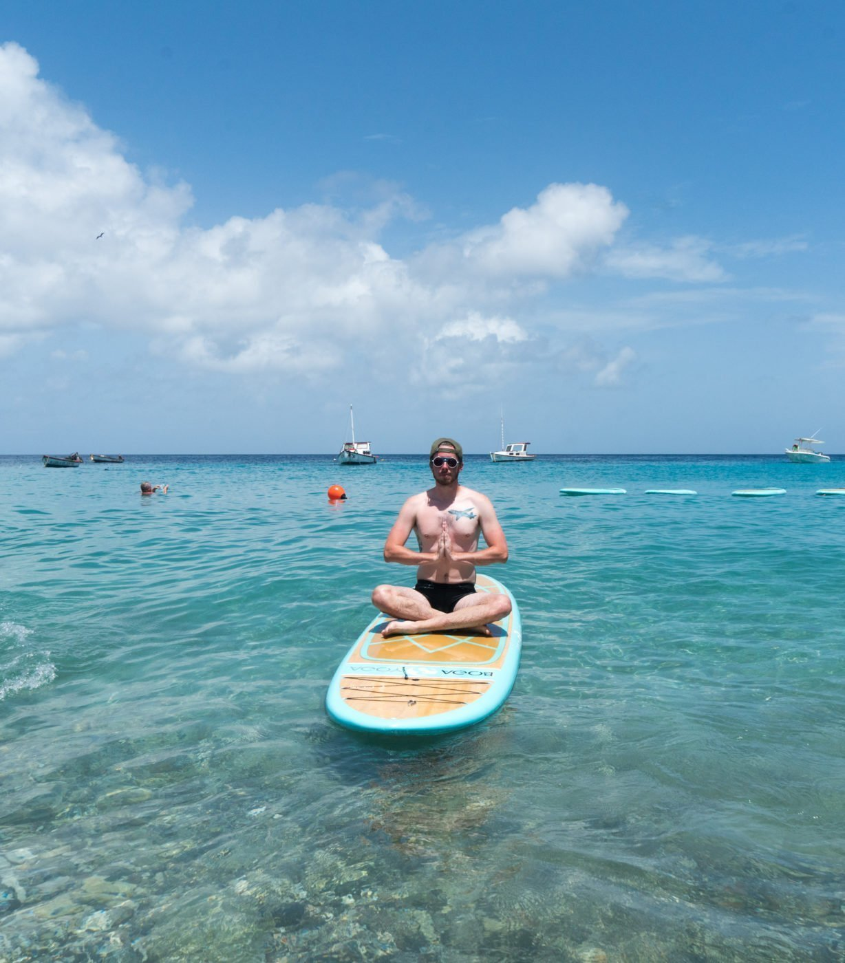 Me doing SUP Yoga with Dushi Sup in Curaçao. Boga yoga boards