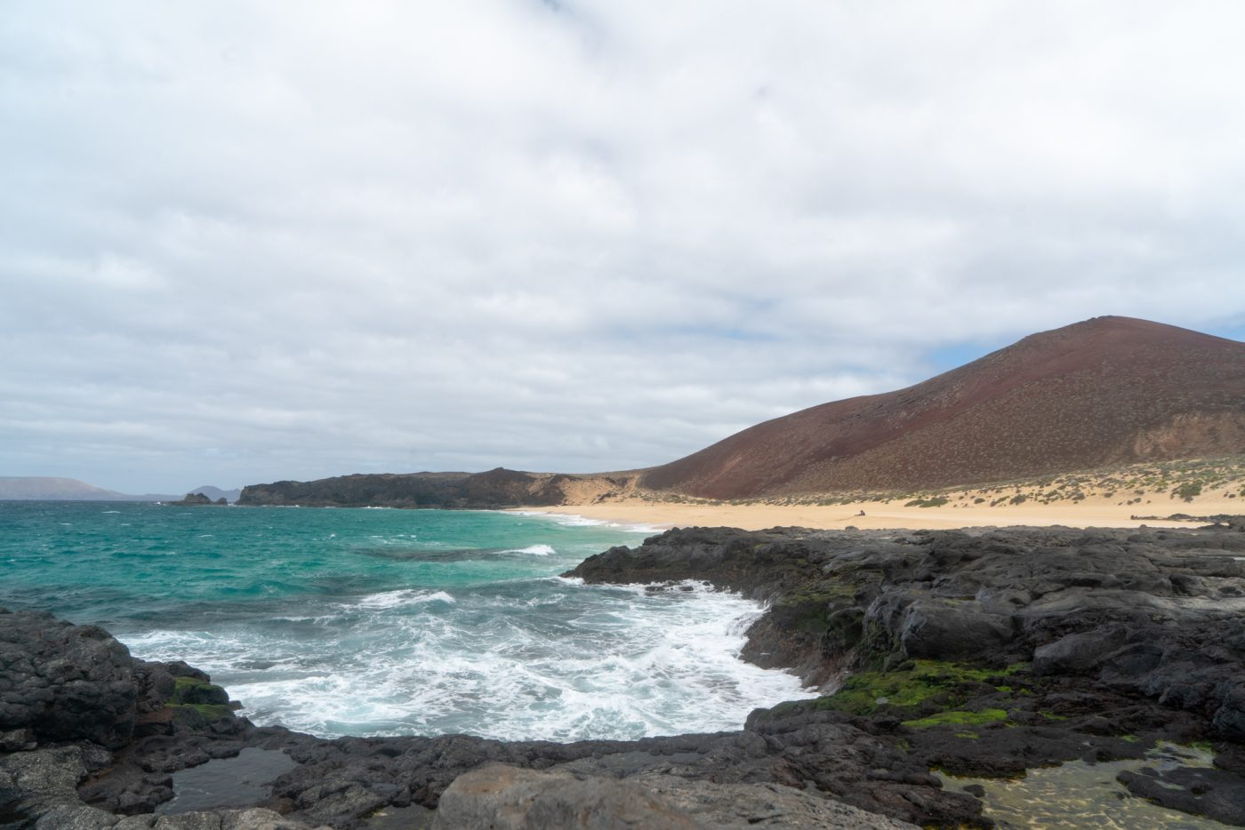Take the ferry to visit Playa de las Conchas on La Graciosa