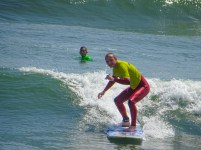 Alejandro teaching Ben to surf in Huanchaco