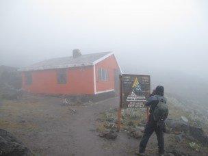 Taking a picture at the Iliniza Norte refuge as my phone dies