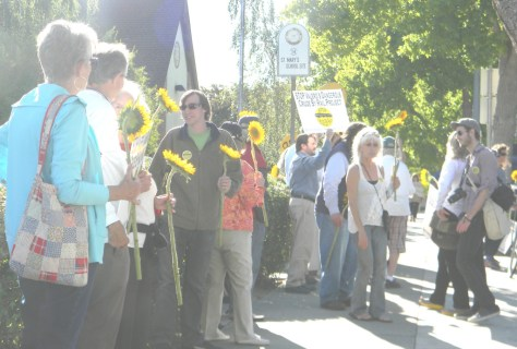 OPPONENTSof Valero's Crude-by-Rail Project rallied in front of City Hall on Thursday, holding sunflowers to honor the residents of Lac-Megantic, Quebec, Canada, who died in a fiery train accident in 2013. Donna Beth Weilenman/Staff