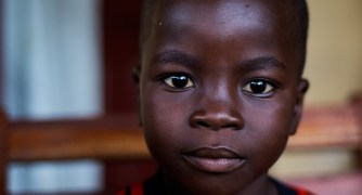 John,5, from Liberia lost both parents. He´s one of estimated 3700 orphans (Unicef). ©Plan International/Neil Brandvold