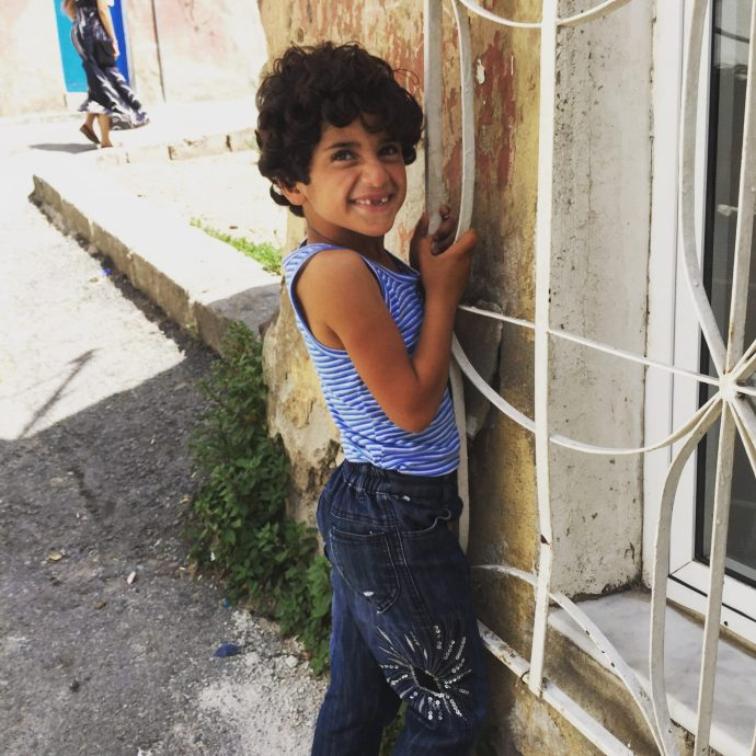 Little Toothy Boy, refugee child on the streets of Izmir
