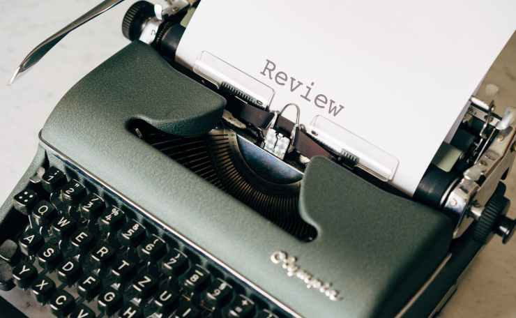 black and white typewriter on table