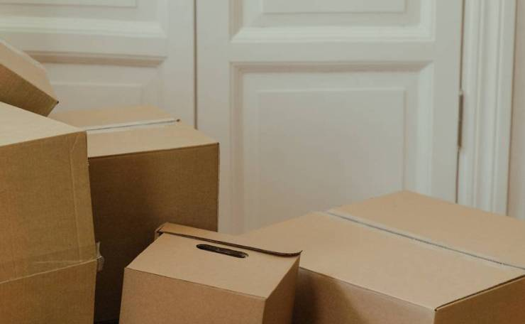 brown cardboard box on white wooden door