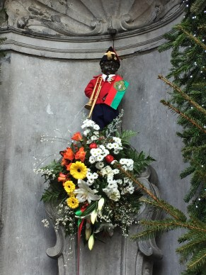 We found Manneken Pis! Yes, it is a statue of a little boy peeing. I hope that is water....