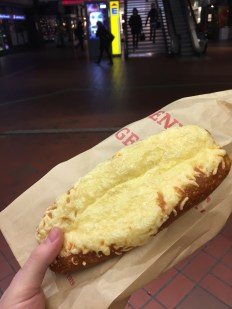 Breakfast at the train station! A cheese-covered pretzel.