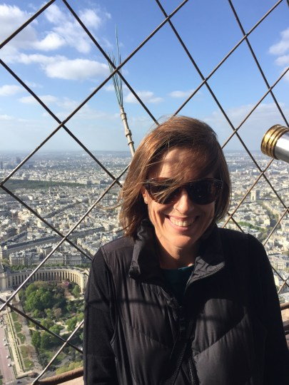 Standing on the Eiffel Tower, overlooking all of Paris.