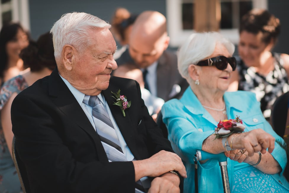 grandparents of the bride watch on during wedding ceremony