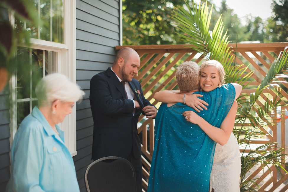 bride hugs officiant