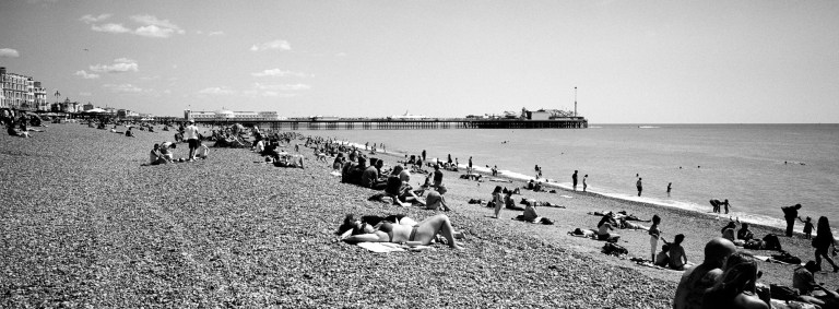 panormaic view of brighton beach shot with a hasselblad xpan and kodak tri-x 400 B&W film, shot by ben lee photography