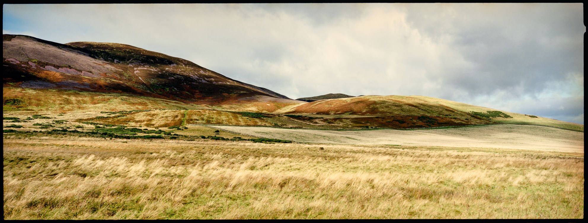 Rolling hills in scotland, shot on ektar 100 film with a hasselblad xpan