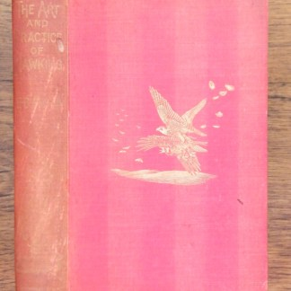 book with red cover - The Art and Practice of Hawking by E.B. Michell