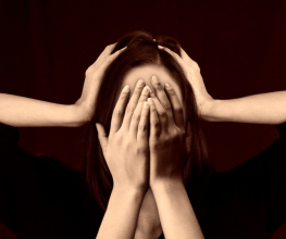 woman with hands over her face- unconscious bias