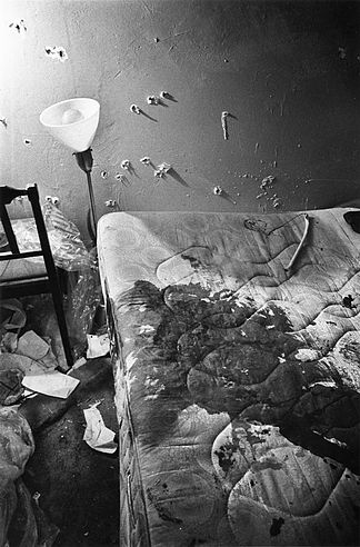 Fred Hampton's apartment after the police raid, with the blood-soaked mattress on which he was sleeping when he was shot and scores of bullet holes in the wall SOURCE: Paul Sequeira / Chicago Reader