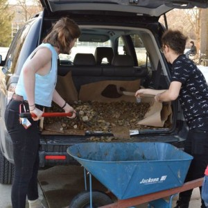 Oberlin SFP students transporting the stones