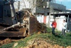 Rachel Corrie protesting Israeli house demolitions in occupied Rafah, Gaza