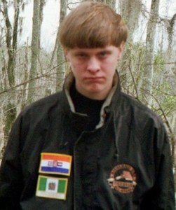 Dylann Storm Roof in his Facebook profile pictures, wearing apartheid flag patches