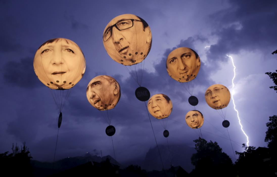 Lightning strikes the Alpine mountains as balloons depicting leaders of the G7 countries are inflated in Garmisch-Partenkirchen