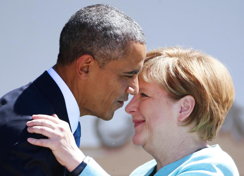 German Chancellor Merkel and U.S. President Obama embrace as they visit Kruen