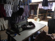 Ghanaian tailor puttin the final touches on a traditional Akan smock for Bryant.