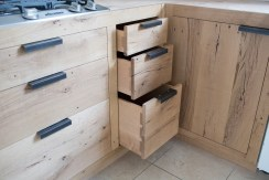 hand-chopped dovetail drawers throughout the kitchen. Reclaimed white oak drawer faces. Handmade steel pulls.
