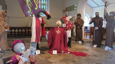 Murder in the Cathedral - Scarecrows at St Michael and All Angels church in Pirbright, Surrey. Pirbright Scarecrow Festival 21 June 2014.